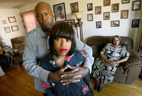 Hooks' husband, Alvin Hooks, left, their daughter, Alnisha, 20, and mother-in-law Catherine Green, 72.