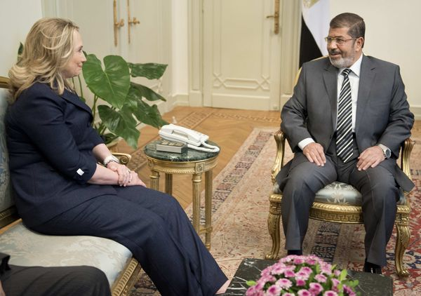 U.S. Secretary of State Hillary Clinton meets with Egyptian President Mohammed Morsi at the presidential palace in Cairo on July 14, 2012.