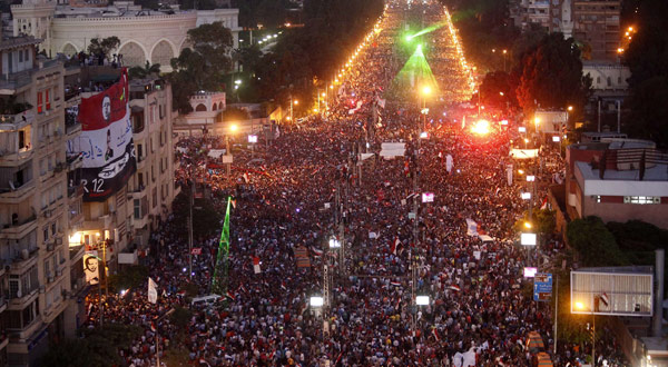 Hundreds of thousands of Egyptian demonstrators gather outside the presidential palace in Cairo during a protest.
