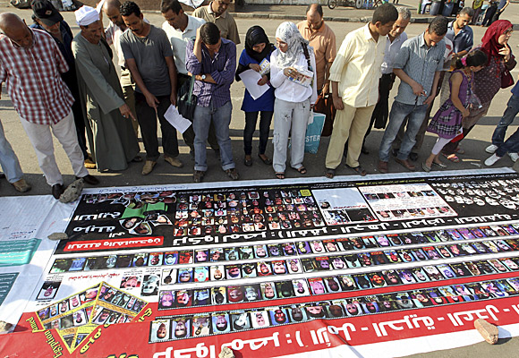 In Cairo's Tahrir Square, a banner is displayed with photos of some of the people killed during the uprising in Egypt.