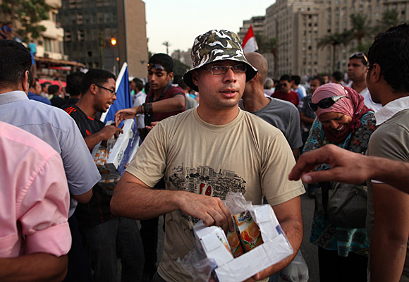 Ahmed Maher hands out juice to demonstrators in Cairo's Tahrir Square.