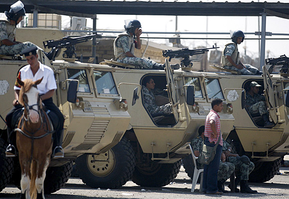 Soldiers stand guard at the court near Cairo where Hosni Mubarak and others are on trial.