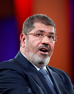 Egyptian President Mohamed Morsi, shown speaking last month at the Clinton Global Initiative in New York, has offered a blanket pardon of hundreds of activists arrested during last year's revolution and its aftermath.