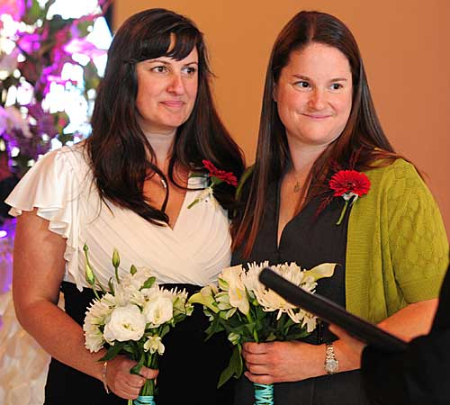 Julia Fraser, left, and Jessica Rohrbacher get married.