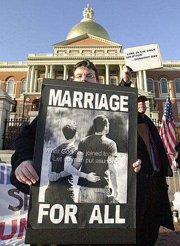 A supporter of gay marriage holds a sign outside the Massachusetts State House.