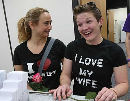 Alicia Atkinson, left, and Laurin Fabry, right, convert their civil union to a marriage license at the DuPage County Clerk's office in Wheaton, Ill.