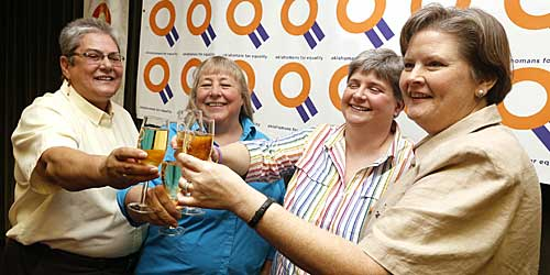 Plaintiffs Sue Barton, her partner Dr. Gay Phillips, Sharon Baldwin, and her partner Mary Bishop have a champagne toast during a celebration of a decision by the 10th Circuit Court of Appeals.
