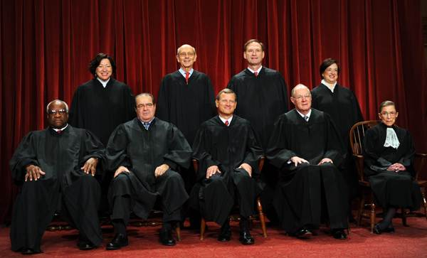 The Supreme Court justices sit for their official photograph in 2010. Seated from left are: Associate Justices Clarence Thomas, Antonin Scalia, Chief Justice John Roberts, Associate Justices Anthony M. Kennedy and Ruth Bader Ginsburg. Standing from left are: Associate Justices Sonia Sotomayor, Stephen Breyer, Samuel Alito Jr. and Elena Kagan.
