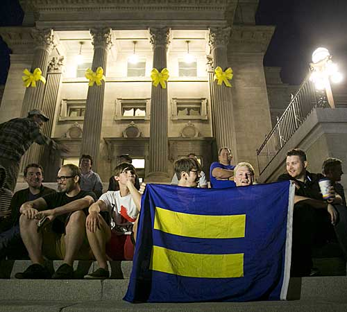 Same-sex marriage supporters gather on the steps of the Idaho Statehouse in Boise after U.S. Magistrate Judge Candy Wagahoff Dale ruled that Idaho's ban on gay marriage is unconstitutional.