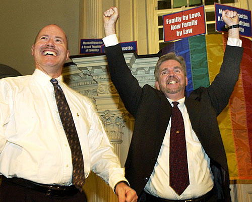 Ed Balmelli, left, and Michael Horgan, one of seven gay couples who sued the state of Massachusetts, celebrate in Boston.