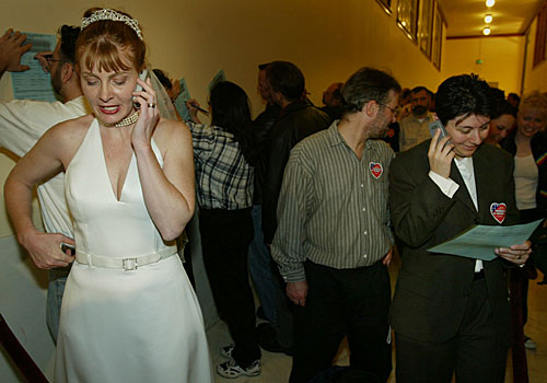Molly McKay, left, phones relatives to tell them of her marriage to partner Davina Kotulski, also on a phone at right.