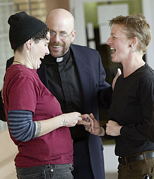 Beth Hill, left, and Christin Boyd exchange vows under the guidance of the Rev. David Gant, but the state later said their license was invalid.