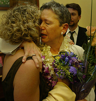 Pali Cooper, left, hugs partner Jeanne Rizzo after learning that they could not be married.