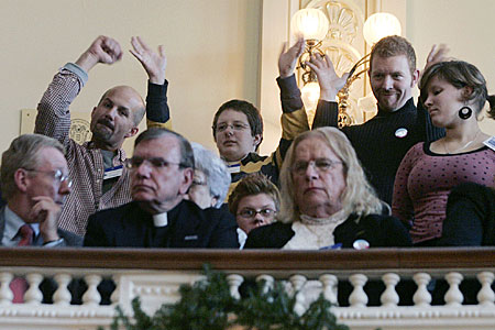 Supporters wave from the gallery as the civil unions bill is debated in the New Jersey Assembly.