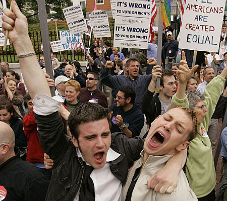 Greg Kimball, left, of Manchester, Mass., and his partner, Brian O'Connor, celebrate after Massachusetts lawmakers blocked a statewide vote to ban same-sex marriage.