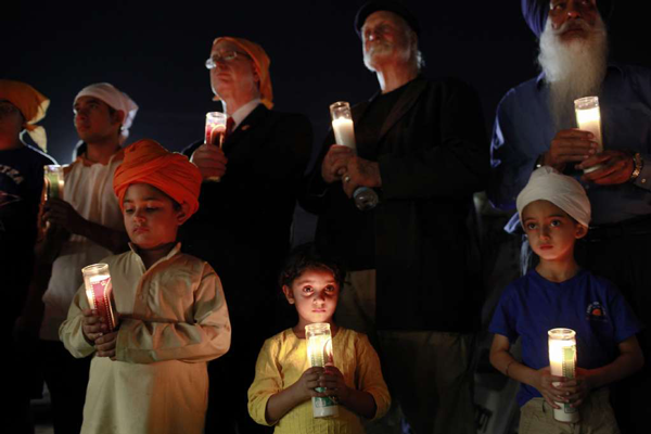 People gathered at the Khalsa Care Foundation in Pacoima, for a candle vigil, to remember the victims of the Wisconsin Sikh temple shooting