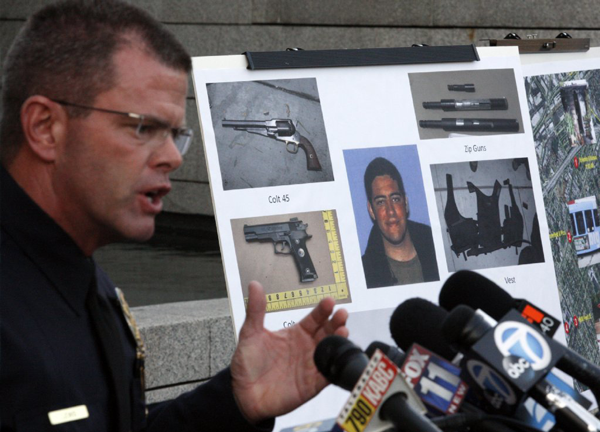 Santa Monica Police Sgt. Richard Lewis speaks about the replica weapons and zip guns found during a search of John Zawahri's house.