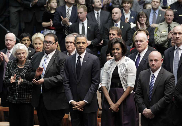 President Barack Obama and first lady Michelle Obama attend memorial service for the victims of Saturday's shootings, at McKale Center on the University of Arizona campus Wednesday, Jan. 12, 2011, in Tucson, Ariz.