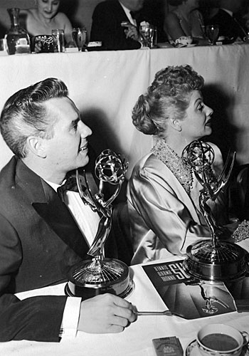 "Lucille Ball and her husband, Desi Arnaz, attend the Emmys and receive an award for their show, ""I Love Lucy."""
