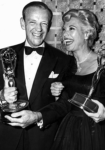 "Fred Astaire, who won nine awards for ""An Evening With Fred Astaire,"" alongside lead actress winner Dinah Shore."