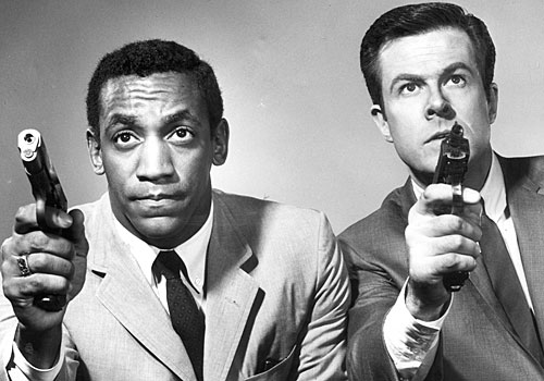 "Bill Cosby, left, and Robert Culp as partners in ""I Spy."""
