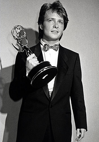 "Michael J. Fox shows off his actor award for ""Family Ties."""