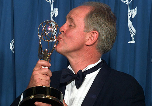John Lithgow kisses his Emmy.