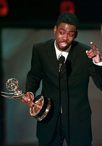"Chris Rock holds his Emmy for writing for a variety or music program for ""Bring the Pain."""