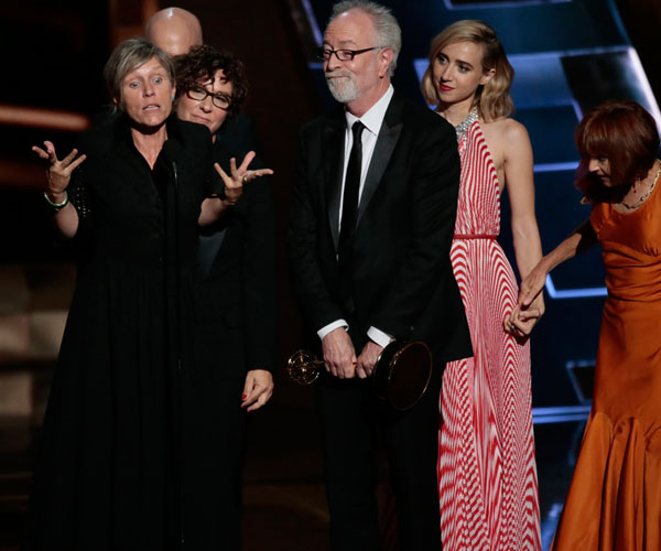 "Frances McDormand, left, and other members of the cast and crew of ""Olive Kitteridge"" accept the limited series award."