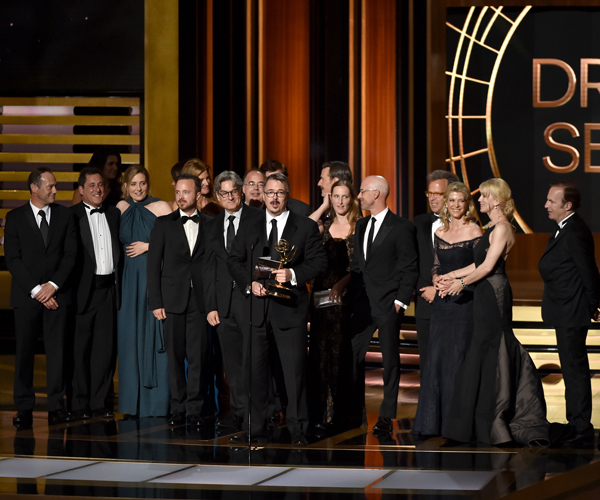 "Show creator Vince Gilligan of ""Breaking Bad,"" center, is shown with cast and crew as they accept the Emmy for drama series."