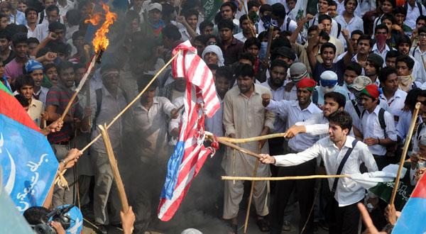 Pakistani activists burn a US flag during a protest against the anti-Islam movie in Lahore.