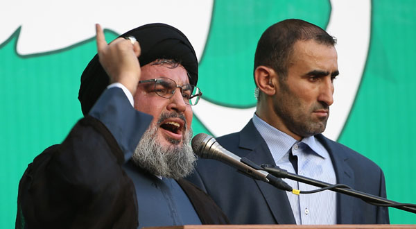 Hezbollah leader Sheik Hassan Nasrallah, left, speaks to a crowd of tens of thousands of supporters during a rally denouncing an anti-Islam film that has provoked a week of unrest in Muslim countries worldwide.