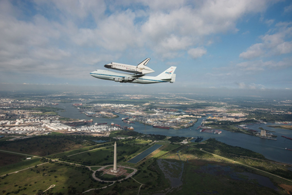 The space shuttle Endeavour is ferried over San Jacinto Monument in Houston on Wednesday.