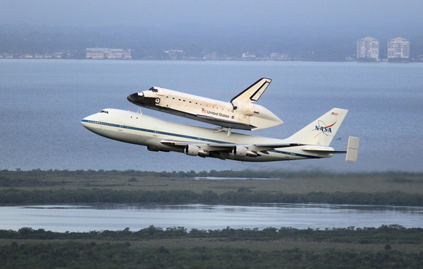 The space shuttle Endeavour rides atop a Boeing 747 after taking off from Kennedy Space Center on Wednesday.