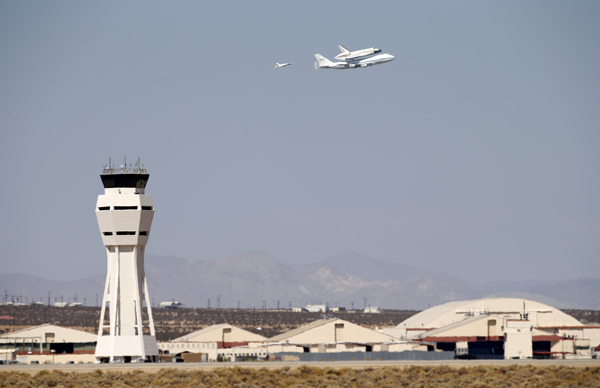 The space shuttle Endeavour mounted on NASA's carrier aircraft flies over Edwards Air Force Base on Thursday.