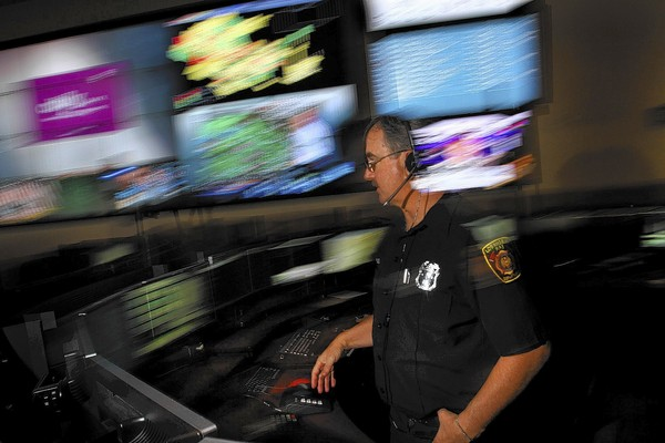 LAFD dispatcher Steve Bloch talks with a colleague about a call.