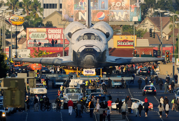 The space shuttle Endeavour is transported to The Forum arena for a stopover and celebration on its way to the California Science Center on Saturday.