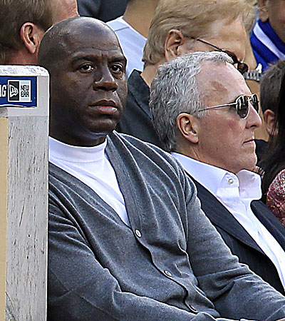 Magic Johnson with Frank McCourt at the Dodgers' opener in San Diego.