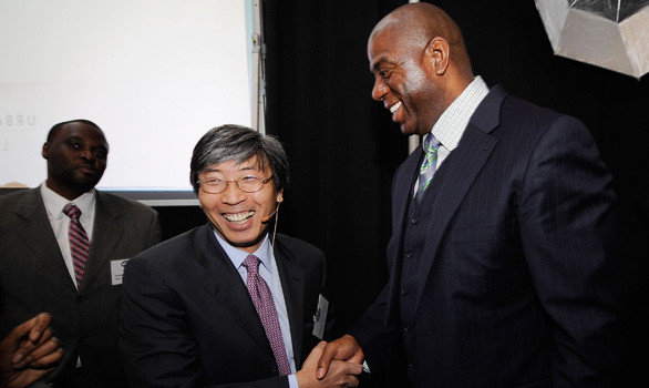 Patrick Soon-Shiong and former Lakers great Magic Johnson are part of two separate groups that are bidding for the Dodgers.