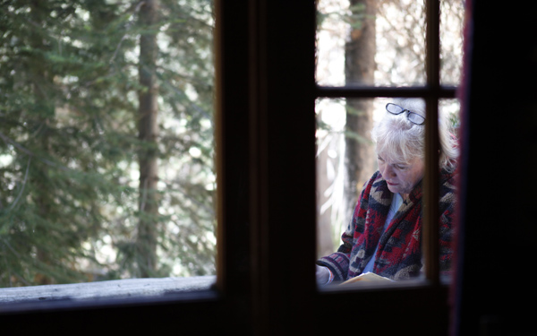Mary Breckenridge prepares for her trans–Sierra trip at her cabin in Lake Huntington.
