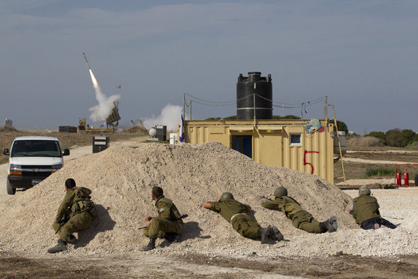 A missile is launched from a battery that's part of the Iron Dome system to intercept a rocket fired by Palestinian militants in the Gaza Strip.