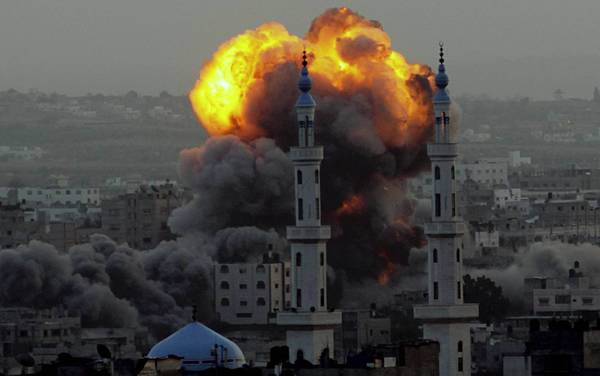 Smoke rises after an airstrike southeast of Gaza City that Israel says was aimed at a Hamas site.