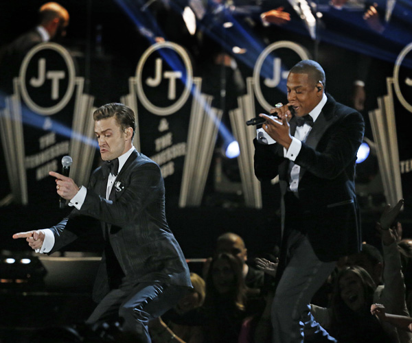 "Justin Timberlake, left, performs his song ""Suit and Tie,"" featuring rapper Jay-Z at the 55th Grammy Awards."