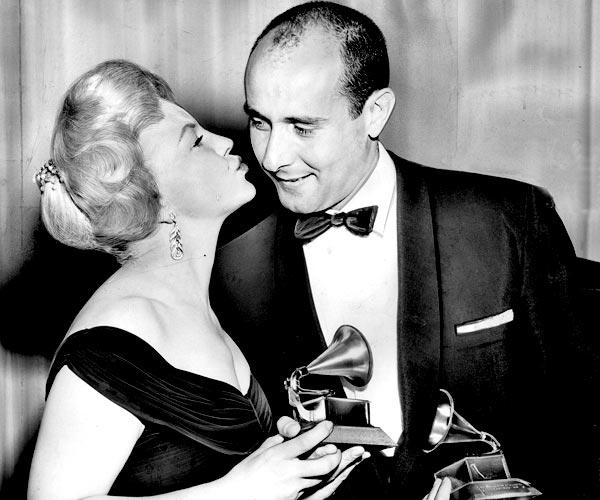 "Peggy Lee presents the Grammy for album of the year to Henry Mancini for ""Peter Gunn,"" which also wins for best arrangement."