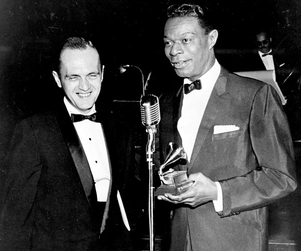 Bob Newhart, left, and Nat King Cole speak during the Grammy Awards ceremony in 1961.