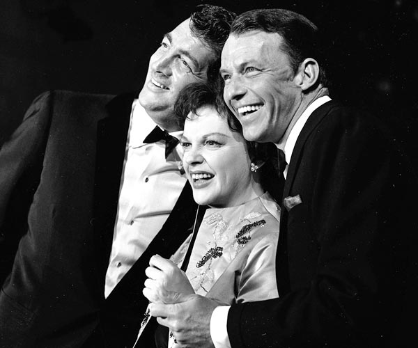 "Judy Garland is flanked by Dean Martin, left, and Frank Sinatra in a still from the television concert special ""The Judy Garland Show,"" directed by Norman Jewison."