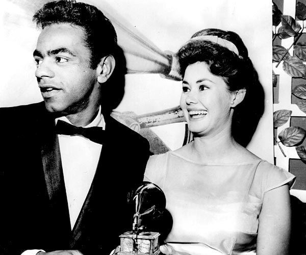 Singers Johnny Mathis and Roberta Shore, photographed at a dinner for the Grammy Awards in 1965.