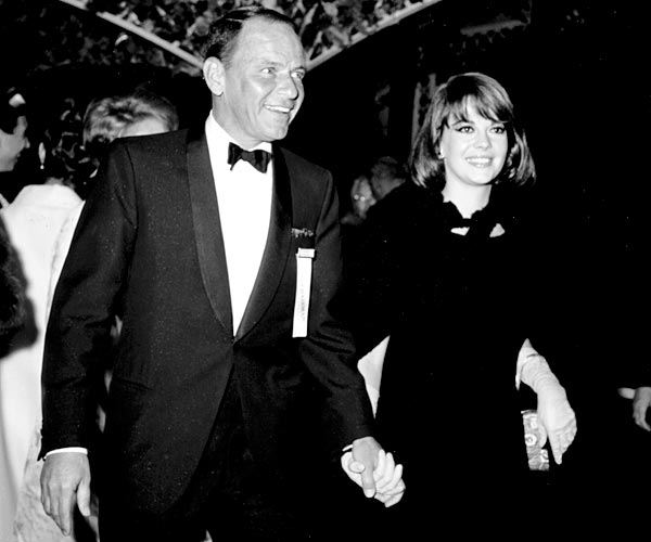 Frank Sinatra and Natalie Wood attend an event in Los Angeles in 1966.