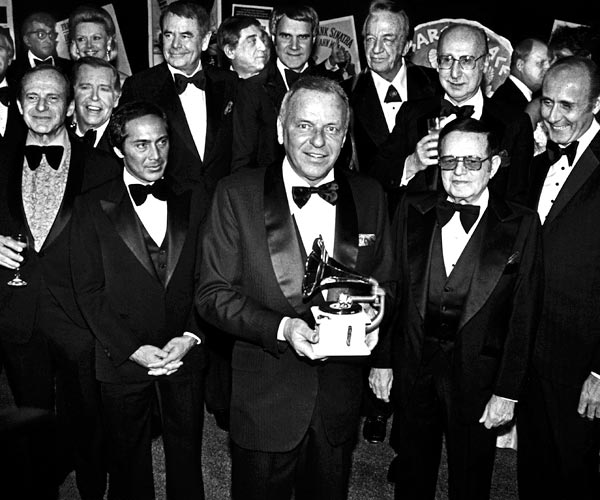 Frank Sinatra is honored by celebrity friends Paul Anka, Glenn Ford, Phil Harris, Rich Little, Red Skelton, Julie Styne, Dean Martin, Dina Merrill and Henry Mancini in 1979.
