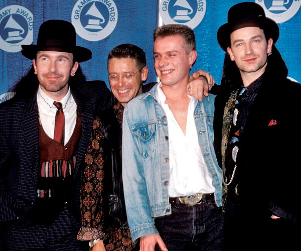 Left to right: U2's The Edge, Adam Clayton, Larry Mullen Jr. and Bono attend the 1988 Grammy Awards.
